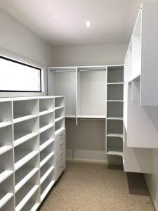 white walk in wardrobe multiple shelves