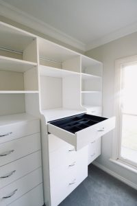 white walk in wardrobe with jewellery drawer