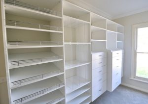 white walk in wardrobe shoe shelves