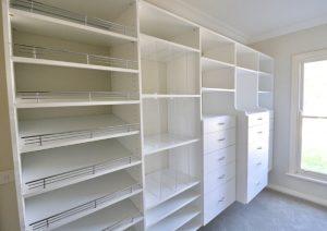 white walk in wardrobe shoe shelves